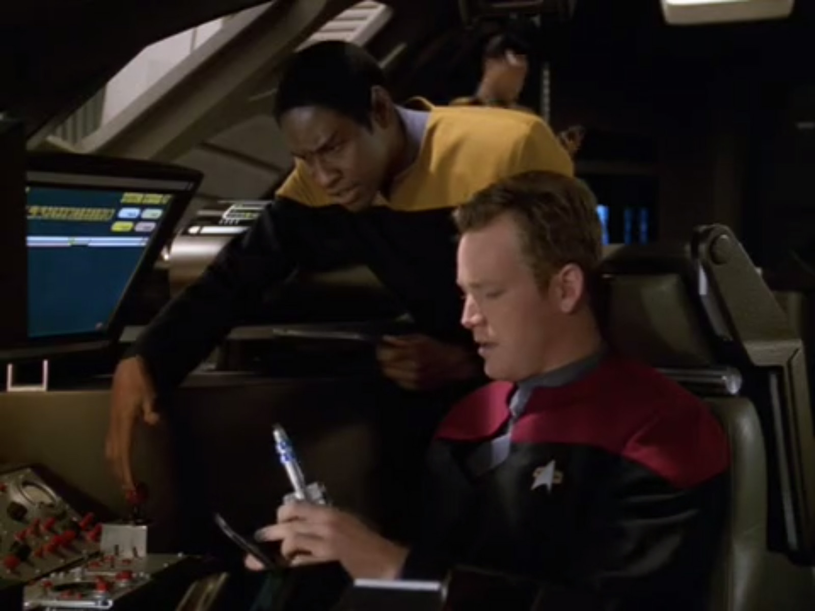 Star Trek Voyager Tuvok pointing at shuttle knobs